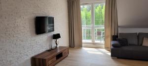 Telewizja i/lub zestaw kina domowego w obiekcie Apartament 44