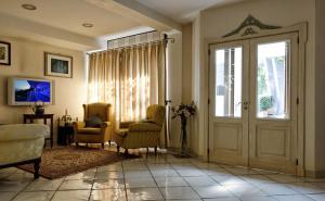 A seating area at Villa Poseidon Boutique Hotel & Events