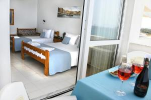 A bed or beds in a room at Klinakis Beach Hotel