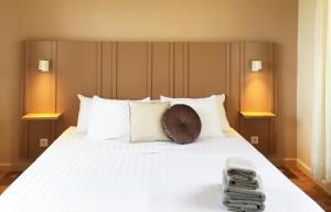 Een bed of bedden in een kamer bij CuraVilla