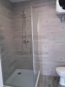 Łazienka w obiekcie Kuchciak Apartments