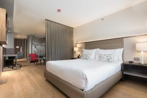 A bed or beds in a room at Hotel Habitel Prime