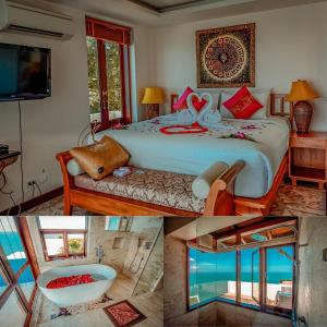 A bed or beds in a room at Sandalwood Luxury Villa Resort
