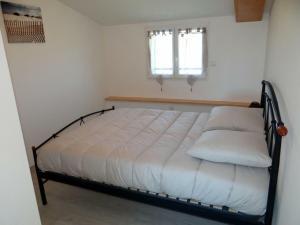 Un ou plusieurs lits dans un hébergement de l'établissement Gîte Lacrabe, 3 pièces, 4 personnes - FR-1-360-332
