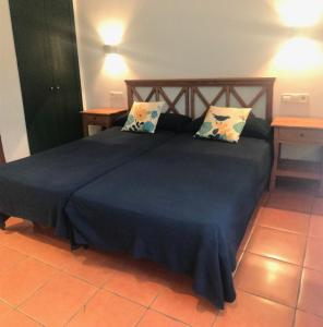 Cama o camas de una habitación en Hospedería Rural Aldeaduero