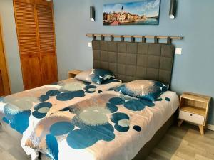 Un ou plusieurs lits dans un hébergement de l'établissement Maison d'hôtes Côté Saône