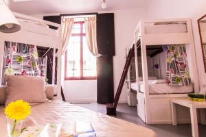 A bed or beds in a room at Lisbon Destination