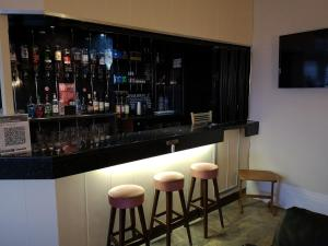 The lounge or bar area at Rockcliffe Hotel