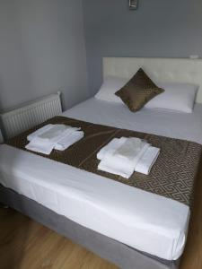 A bed or beds in a room at My Way Cadde Butik Otel