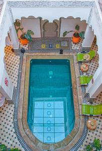 A view of the pool at Hotel Riad Amlal or nearby
