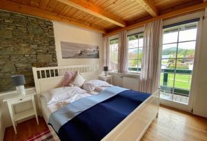 Ein Bett oder Betten in einem Zimmer der Unterkunft Landhaus Klopein