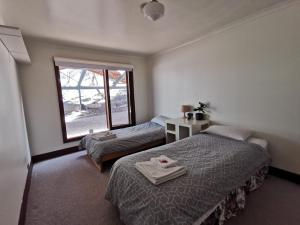 A bed or beds in a room at Cellar House