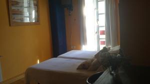 A bed or beds in a room at La Montañesuca