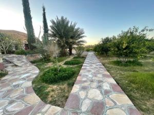 Um jardim em Naseem Al Atheeb Country House