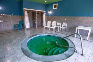 The swimming pool at or near MorningGlory Hotel, Resort & Suites