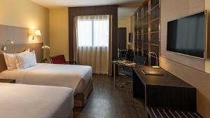 A bed or beds in a room at Mercure Ribeirao Preto