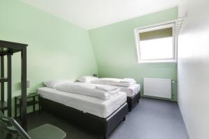 A bed or beds in a room at Hans Brinker Hostel Amsterdam