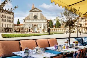 A restaurant or other place to eat at The Place Firenze