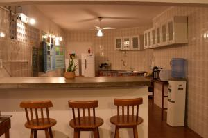 A kitchen or kitchenette at Enero Suites & Sports