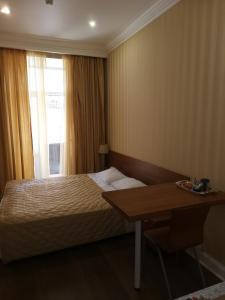 Кровать или кровати в номере Apart MAX