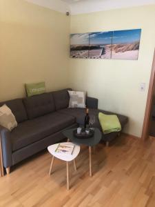 Ein Sitzbereich in der Unterkunft Ferienwohnungen Eberhard, Altes Winzerhaus