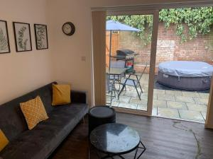 A seating area at Watford Stays by Stay Guru
