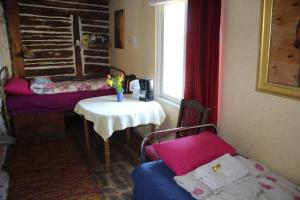 A bed or beds in a room at Suur-Lossi Apartments