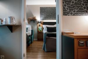 Våningssäng eller våningssängar i ett rum på Quality Hotel Panorama
