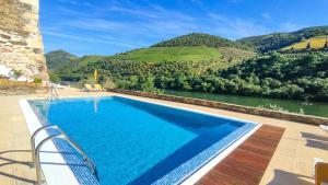 The swimming pool at or near Hotel Casa do Tua