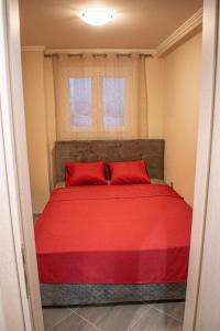 A bed or beds in a room at Comfortable apartment near Athens Airport!!