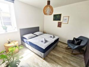 A bed or beds in a room at Apartmány Ve stodole
