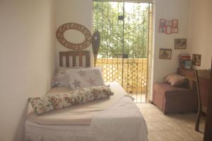 A bed or beds in a room at Hospedagem com cultura Afro