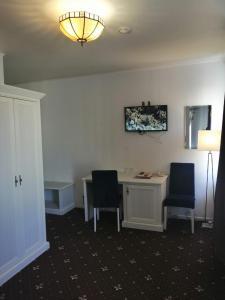 Телевизор и/или развлекательный центр в Апарт-отель Наумов