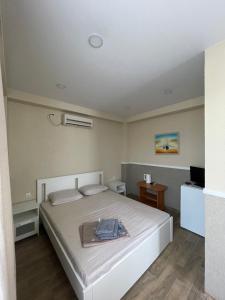Кровать или кровати в номере Звездочка