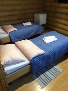 Кровать или кровати в номере Арт-Эко-Отель Алтай