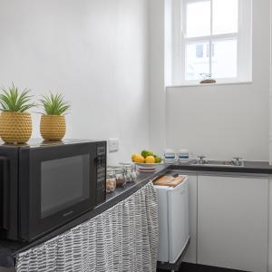 A kitchen or kitchenette at The Edgcumbe Hotel & DECK Restaurant