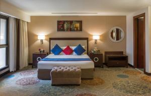 Cama ou camas em um quarto em Mena Hotel Riyadh