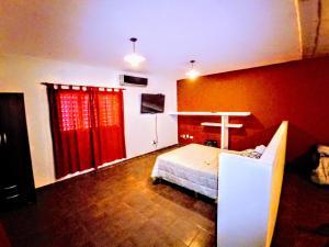 Una cama o camas en una habitación de Departamento La Morenita