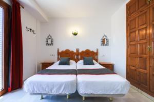 Säng eller sängar i ett rum på Apartamentos Pepe Mesa