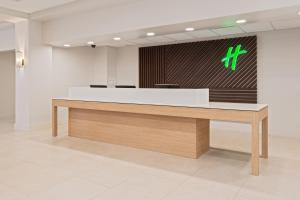 The lobby or reception area at Holiday Inn & Suites Across From Universal Orlando, an IHG Hotel