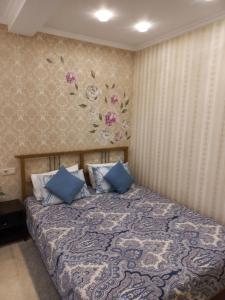 Кровать или кровати в номере Гостевой Дом «Людмила»