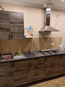 Кухня или мини-кухня в Гостевой Дом «Людмила»