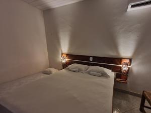 A bed or beds in a room at Pousada Vila Cajuína - Luís Correia