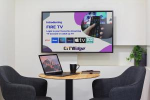 A television and/or entertainment center at City Edge North Melbourne Apartment Hotel