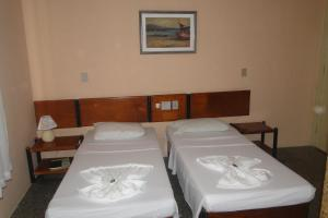A bed or beds in a room at Hotel Ilhéus