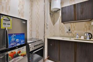 A cozinha ou cozinha compacta de OYO 232 Fawasel Tabuk 2 Hotel Apartment