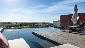 A piscina em ou perto de Vitoria Stone Hotel
