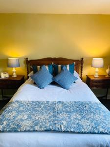 A bed or beds in a room at Softleys