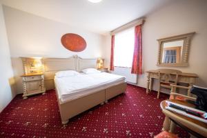 Кровать или кровати в номере Hotel U Kata