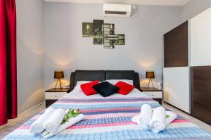 A bed or beds in a room at Holiday Home Lungo Mare